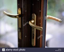 Exterior Single French Door by Door Handles On Glass Patio External French Doors Stock Photo