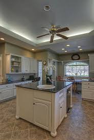 country kitchen with drop in sink u0026 limestone tile floors in