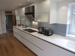 Gloss White Kitchen Cabinets High Gloss White Cabinetry With Antarctica Corian Tops The French