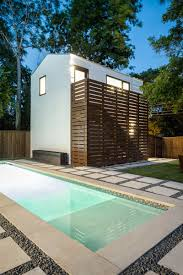 house with separate guest house a detached guest house lap pool and fire pit fill the backyard of