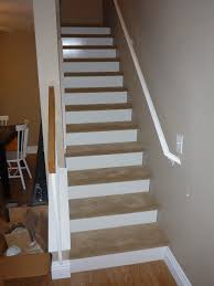 our new stairs 1 8 inch wood white board cut and put on the