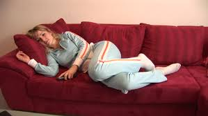 HD Young Blonde Woman In Tracksuit Lying On Couch And Looking - Lying sofa 2