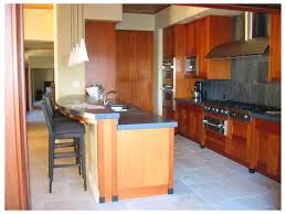 kitchen coffee maker cabinets cooktop bar stool counter top