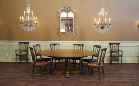 round dining room table with leaf facelift 64 84 round solid oak dining room table with hidden