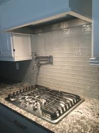 love this glass tile backsplash could paint watercolor style on bianco antico granite mist glass tile backsplash white cabinets 5 burner ge profile