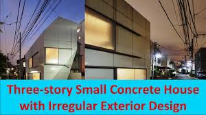 three story small concrete house with irregular exterior design