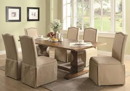 7 piece dining table and parson skirted chair set by coaster