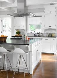 kitchen island vent gourmet kitchen features a stainless steel vent suspended