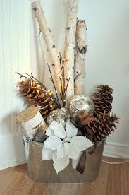 bucket with christmas ornaments and sticks and pinecones repin