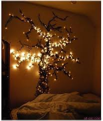 best way to hang christmas lights on wall pretty wall tree strung with christmas lights my home pinterest