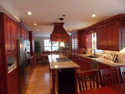 kitchens with cherry cabinets beige tile pattern ceramis laminate