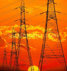 pylons carrying electricity wires at sunset stock image t194