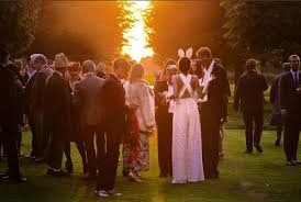 groom wore a chicken head and the bride wore bunny ears