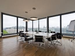 meeting room design ideas with white circular table and black