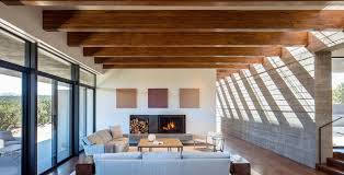 this ridge top house in santa fe is organized around two