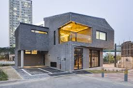 contemporary basalt brick house sustainably built in south korea