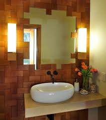 contemporary powder room with wall sconce by beckwith interiors