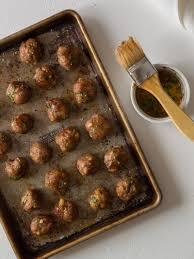 ginger garlic cocktail meatballs spoon fork bacon