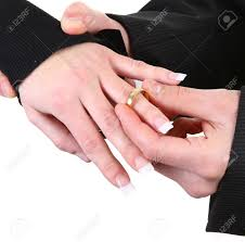 girl hand rings images A guy putting a ring onto a girls hand stock photo picture and jpg