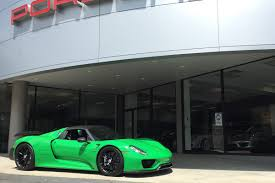 custom porsche 918 indycar driver graham rahal takes delivery of custom green porsche