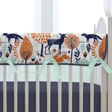 navy and orange woodland crib rail cover carousel designs