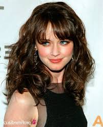 layered haircuts for curly hair haircut for long curly hair with side bangs hairstyles and haircuts
