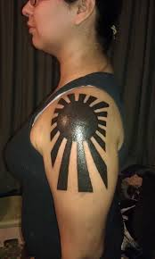 bold black japanese rising sun for shoulder tattoobite
