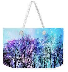 black trees bright pastel space weekender tote bag for sale by
