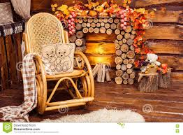 fireplace collected from logs rocking chair and furs stock photo