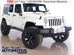 white jeep 4 door jeep wrangler unlimited sahara lifted in texas for sale used