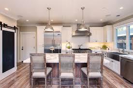 beige walls white trim kitchen farmhouse with wood kitchen island