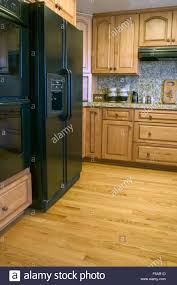 kitchen with oak cabinets u0026 wood floor new appliances and granite
