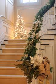 a corner slim tree on the staircase would be a great look for the