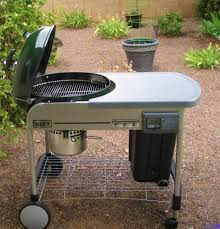 how to build a weber grill table weber performer platinum 22 1 2 in charcoal grill in green 1487001
