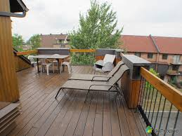 terrace design on rooftop home with chairs and table made