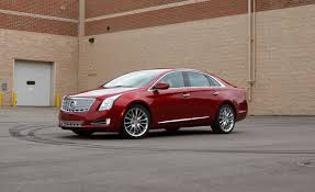 lincoln mks vs cadillac xts 2013 cadillac xts awd platinum test review car and driver