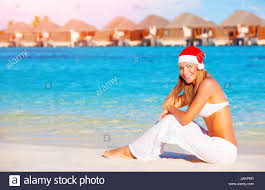 christmas vacation on maldives pretty woman sitting on the beach