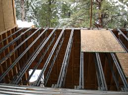 challenges of a downhill mountain lot evstudio architect structural garage floor from above
