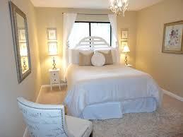 floating black wood platform bed frame neutral bedroom paint