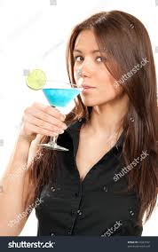 martini tropical woman drinking martini cocktail pretty brunette stock photo