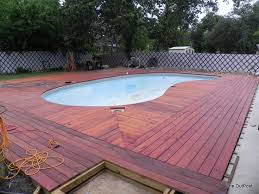 pvc boards around inground pool time to hand paint the top rim