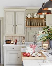 country kitchen with sage green shaker units lovingly repinned