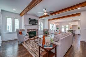 rustic living room with hardwood floors metal fireplace in