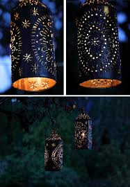 hang these simple tin can lanterns with handles diy home decor