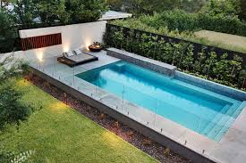 Modern Backyard Fence by Frameless Glass Walls And Simple Contemporary Pool And Landscaping