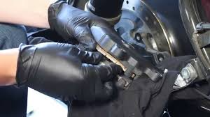 how to replace install inspect brake pads on harley davidson