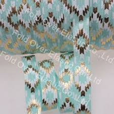 aztec ribbon hot sale 5 8 gold foil aztec printed foe elastic ribbon 314 aqua
