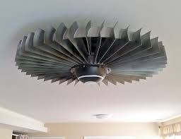 this jet engine ceiling fan and coffee table are way too cool for