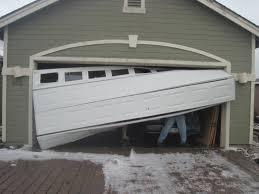 Overhead Door Track Why You Should Not Operate A Damaged Overhead Door