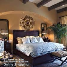 mediterranean style bedroom mediterranean bedroom wood headboard and iron wall accent above